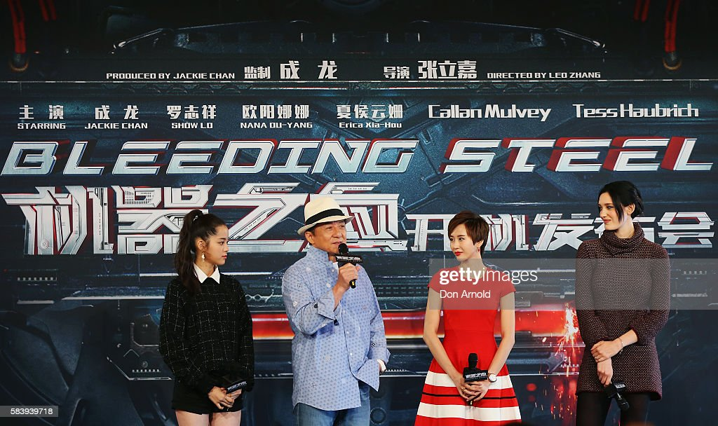 Nana Ouyang,Erica Xia-hou and Tess Haubrich share a laugh as Jackie Chan addresses media during a press conference and photocall for Bleeding Steel at Sydney Opera House on July 28, 2016 in Sydney, Australia.