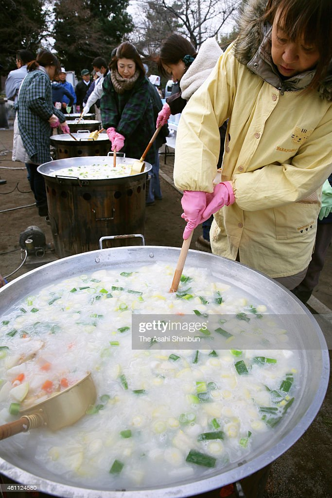 Nanakusa-Gayu', seven-herb rice porridge is cooked during an event on ...
