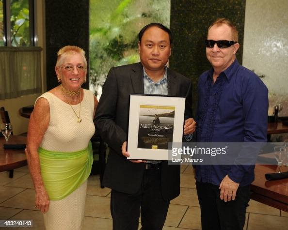 Nanci Alexander 'Blackfish' Producer Manny Oteyza and Fred Schneider attend a PETA event held at Sublime on April 6 2014 in Fort Lauderdale Florida