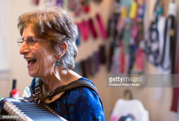 Nancy 3 Hoffman director and curator of the Umbrella Cover Museum has written a theme song for the museum which she sings and plays on accordion at...
