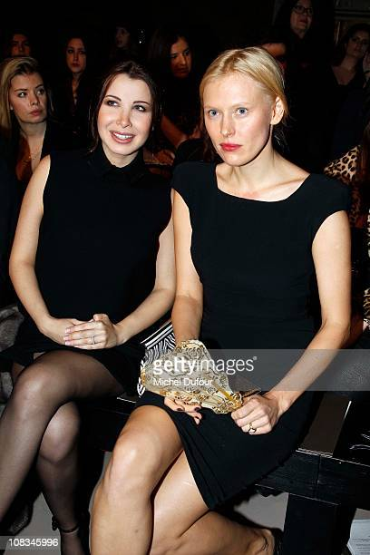 Nancy Ajram and Anna Sherbinina attend the Elie Saab show as part of the Paris Haute Couture Fashion Week Spring/Summer 2011 at Palais de Chaillot on...