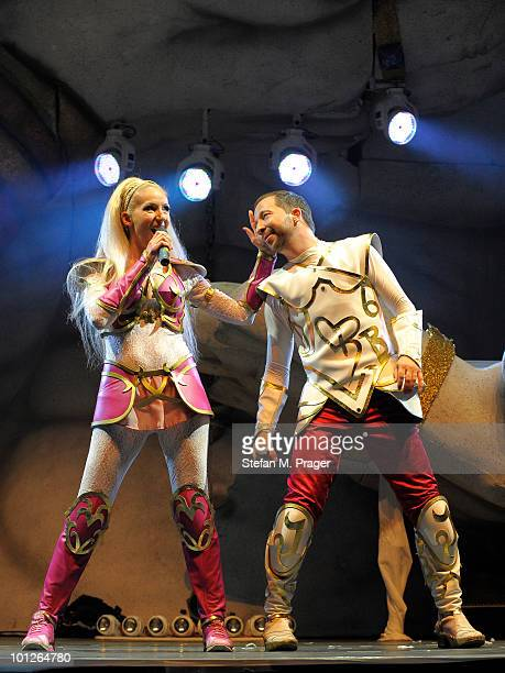 Nancy Baumann and DJ Bobo perform on stage at Olympiahalle on May 29 2010 in Munich Germany