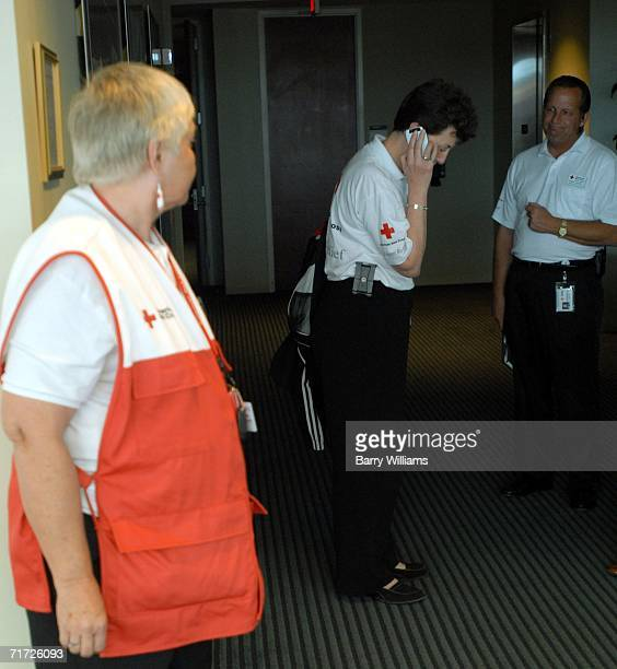 Nancy Brockway Chief Program Officer for the Metro Atlanta Chapter of the American Red Cross checks her cellphone after briefing the media on the Red...