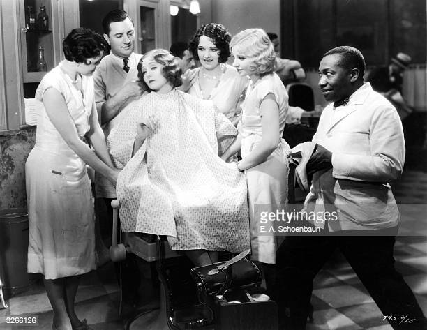 Nancy Carroll makes full use of a barber shop facility in a scene from the Paramount film 'Devil's Holiday'