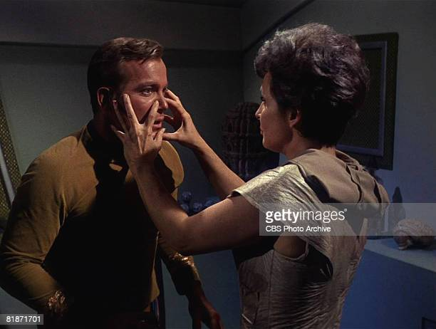Nancy Crater played by American actress Jeanne Bal feels the face of Captain James T Kirk played by Canadian actor William Shatner in a scene from...