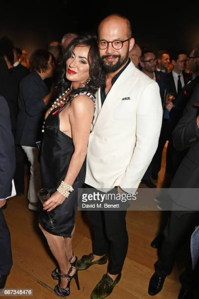 Nancy Dell'Olio and guest attend Terrence Higgins Trust The Auction in support of people living with HIV at Christie's on April 11 2017 in London...