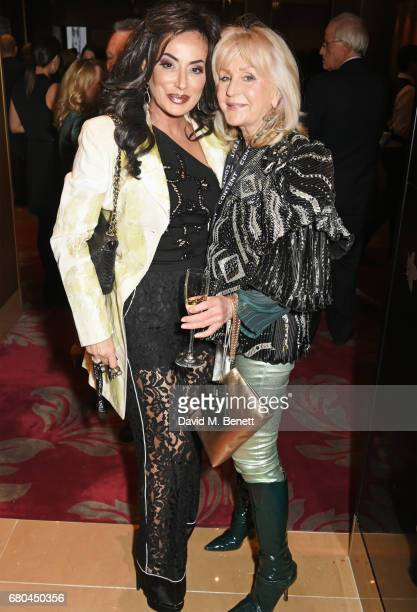 Nancy Dell'Olio and Liz Brewer attend a VIP screening of 'Beside Bowie The Mick Ronson Story' at The May Fair Hotel on May 8 2017 in London England