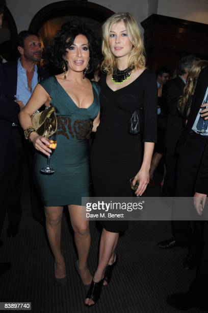 Nancy Dell'Olio and Rosamund Pike attend The Spectator GQ Magazines 'Politics Meet Style' Party at Brown's Hotel in Albemarle Street on December 2...