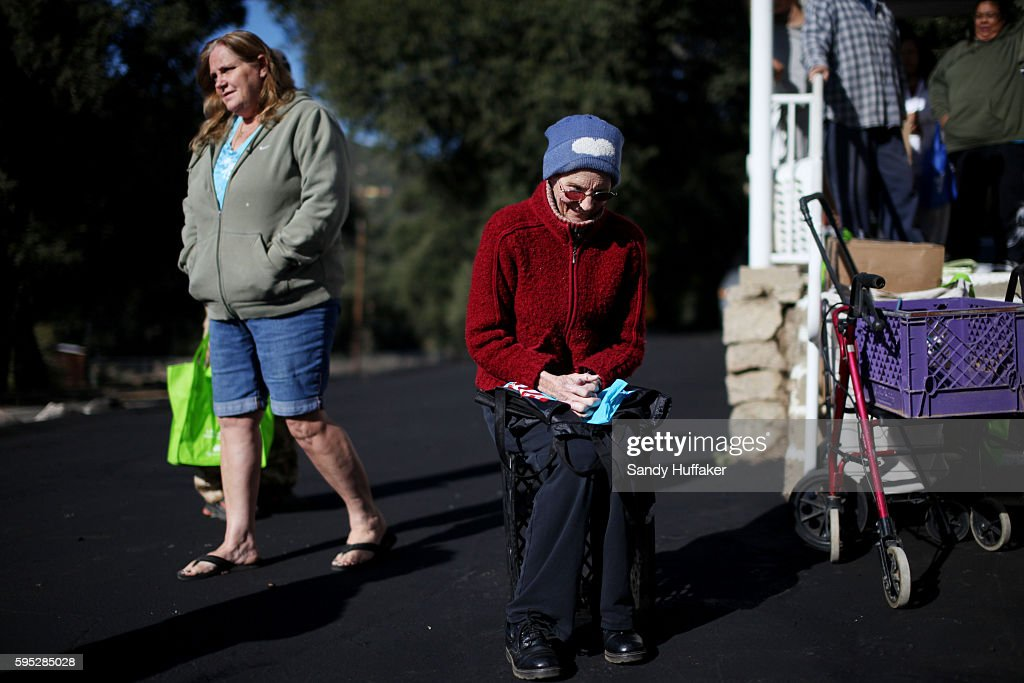 Nancy KerrM who is suffering from cancer waits in line receive donated food items from a Feeding America truck on Thursday November 3 2011 in...