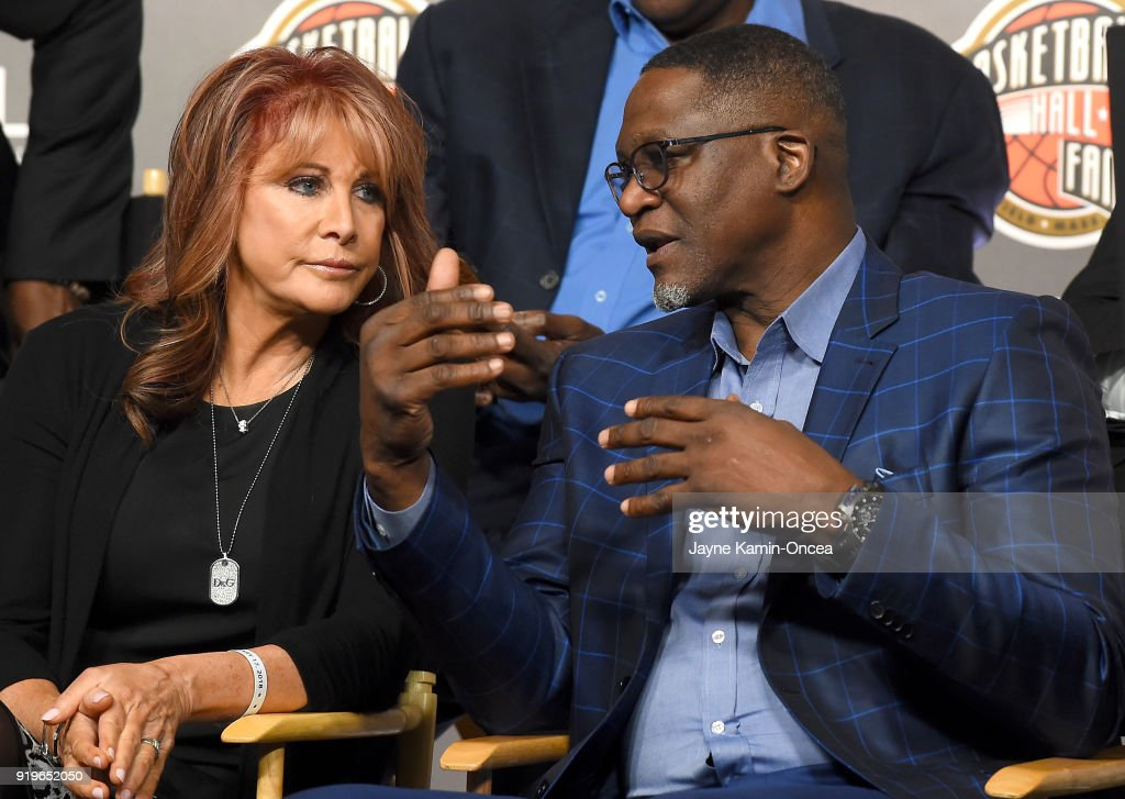 Nancy Lieberman, former WNBA player, talks with Dominique Wilkins, former NBA player, as they attend the Naismith Memorial Basketball Hall of Fame press conference to announced its thirteen finalists for the Class of 2018 Election at Staples Center on February 17, 2018 in Los Angeles, California.