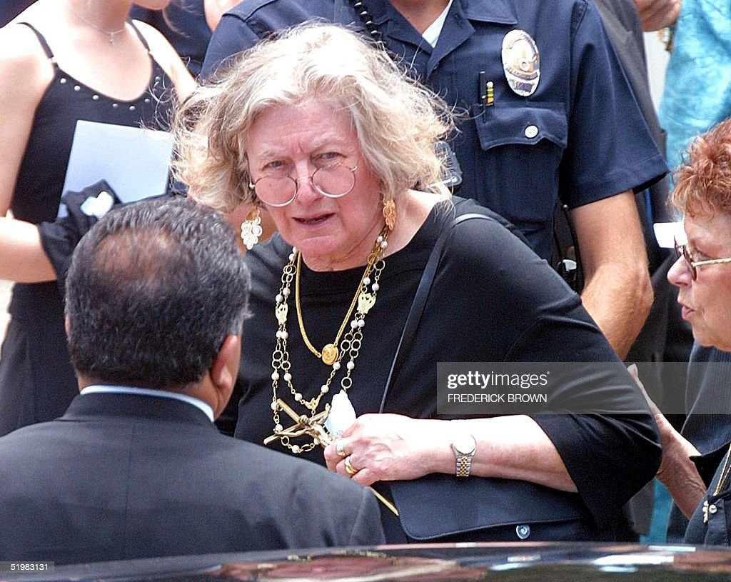 Nancy O'Connor the wife of actor Carroll O' Connor is helped to her car following funeral service for her late husband 26 June, 2001 in Los Angeles, California. The actor many US television watchers will forever remember as TV bigot Archie Bunker in the groundbreaking sitcom 'All in the Family,' died 21 June after suffering a heart attack at his Malibu home.