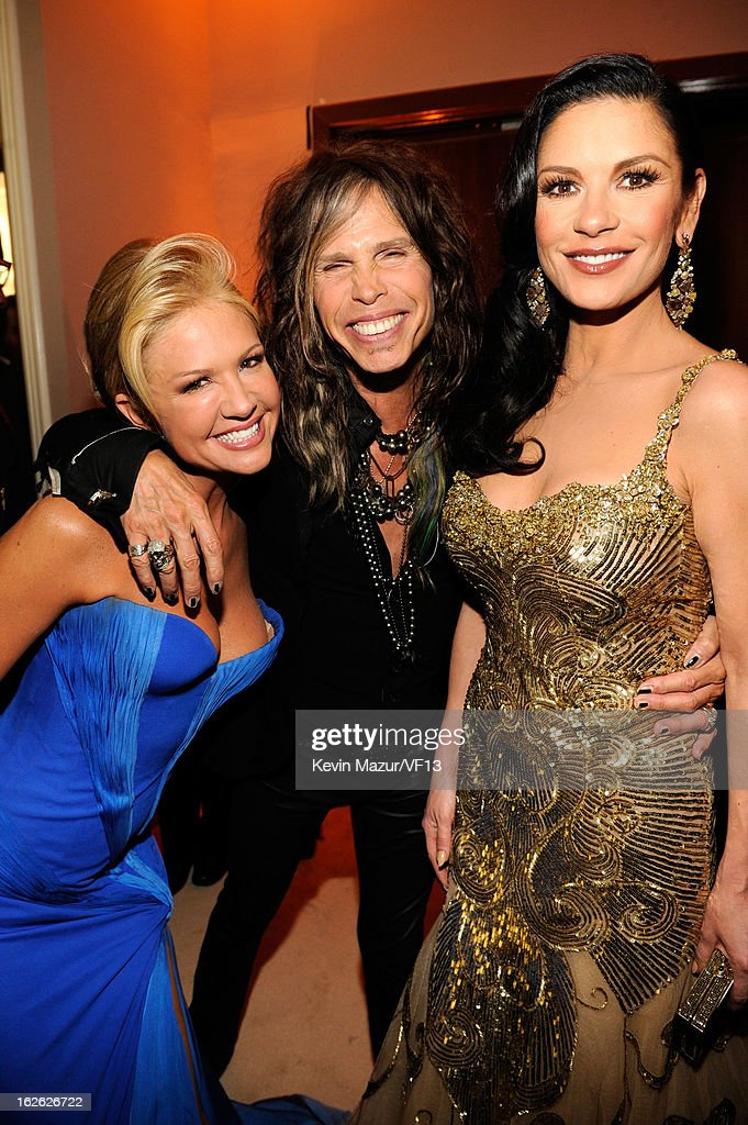 Nancy O'Dell, Steven Tyler and Catherine Zeta-Jones attend the 2013 Vanity Fair Oscar Party hosted by Graydon Carter at Sunset Tower on February 24, 2013 in West Hollywood, California.
