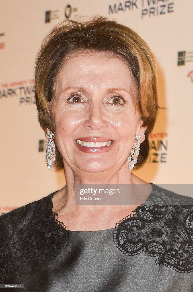 <a gi-track='captionPersonalityLinkClicked' href=/galleries/search?phrase=Nancy+Pelosi&family=editorial&specificpeople=169883 ng-click='$event.stopPropagation()'>Nancy Pelosi</a> poses on the red carpet during The 16th Annual Mark Twain Prize For American Humor at John F. Kennedy Center for the Performing Arts on October 20, 2013 in Washington, DC.