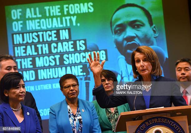 Nancy Pelosi who is the minority leader of the House of Representatives speaks beside House Democrats at an event to protect the Affordable Care Act...