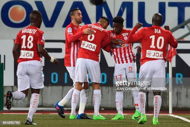 Nancy players celebrate after Nancy's French defender ChristEmmanuel Faitout Maouassa opened the scoring during the French L1 football match between...