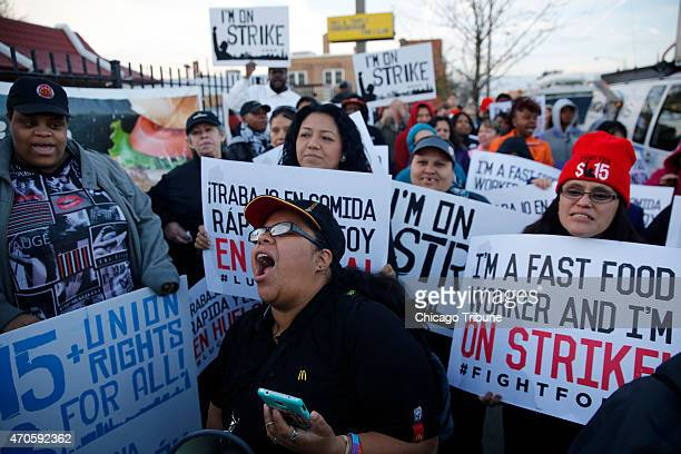 Nancy Salgado center leads chants outside a McDonald's in Chicago during a nationwide day of protests organized by the SEIUbacked Fight for $15...