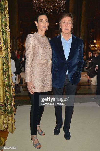 Nancy Shevell and Paul McCartney attend the Stella McCartney show as part of the Paris Fashion Week Womenswear Spring/Summer 2014 on September 30...