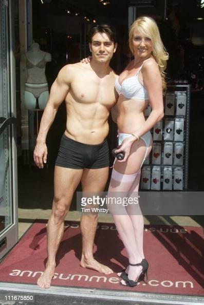 Nancy Sorrell and a male model during Nancy Sorrell Helps Launch the 'Check his Plums' Campaign at Anne Summers Oxford Street in London Great Britain