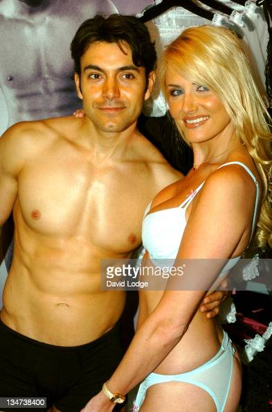 Nancy Sorrell and a male model during Nancy Sorrell Helps to Launch the 'Check His Plums' Campaign at Anne Summers Oxford Street in London United...