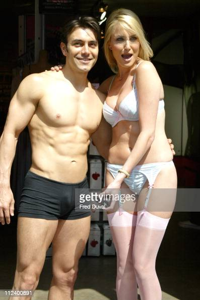 Nancy Sorrell with male model during Nancy Sorrell Helps to Launch the 'Check His Plums' Campaign at Anne Summers Oxford Street in London United...