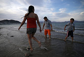 Nancy Veyna stands in the waters of Lake Mead with her sons Kevin Veyna and Luis Veyna at Boulder Beach on May 12 2015 in Lake Mead National...