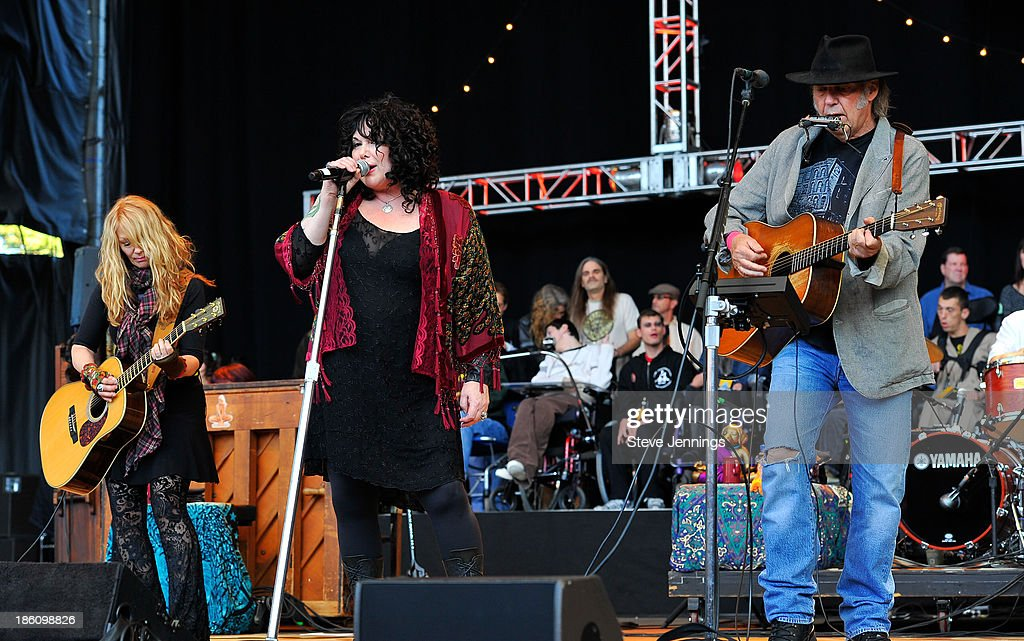 Nancy Wilson, Ann Wilson and Neil Young (L-R) perform on Day 2 of the 27th Annual Bridge School Benefit concert at Shoreline Amphitheatre on October 27, 2013 in Mountain View, California.
