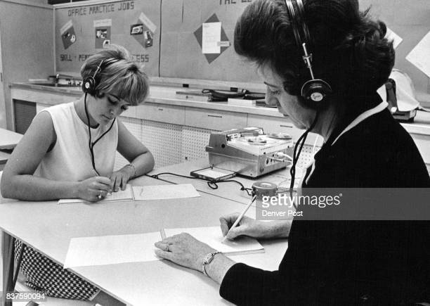 Nancy Young left 3271 S Bannock St and Mrs Harold Shirk 6751 S Gilpin Circle listen intently to their headphones as they practice shorthand Credit...