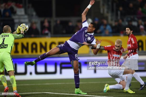 Nancy's Belarussian goalkeeper Sergey Chernik blocks a shot on goal by Toulouse's French defender Christopher Jullien next to Nancy's...