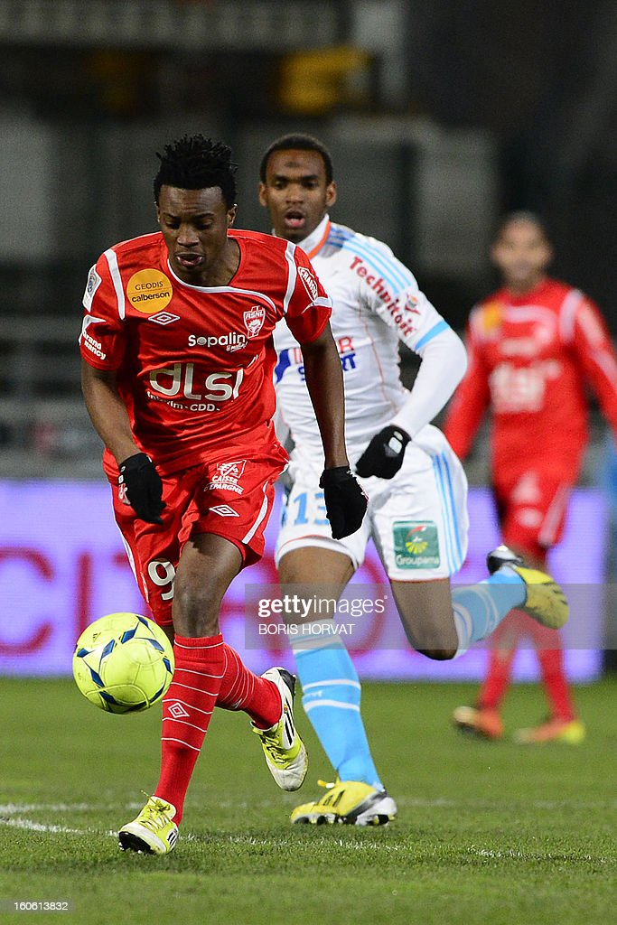 Nancy's Cameroonian forward Benjamin Moukandjo (L) fights for the ball with Marseille's midfielder Rafidine Abdullah (R) during their French L1 football match Olympique of Marseille (OM) versus Nancy (ASNL) at the Velodrome stadium in Marseille on February 3, 2013.