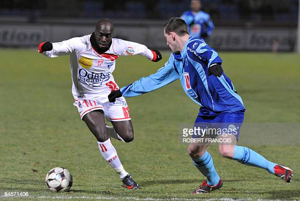 Nancy's forward Issiar Dia vies with Le Havre's defender Peter Franquart during their French L1 football match Le Havre vs Nancy on January 31 at the...