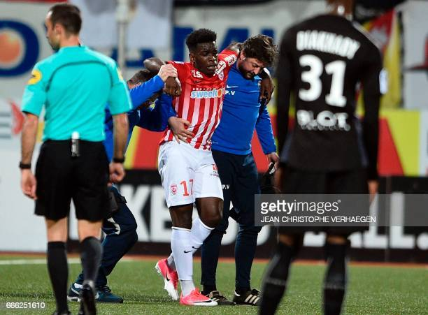 Nancy's French defender Faitout Maouassa leaves the football pitch after an injury during the French L1 football match between Nancy and Rennes on...