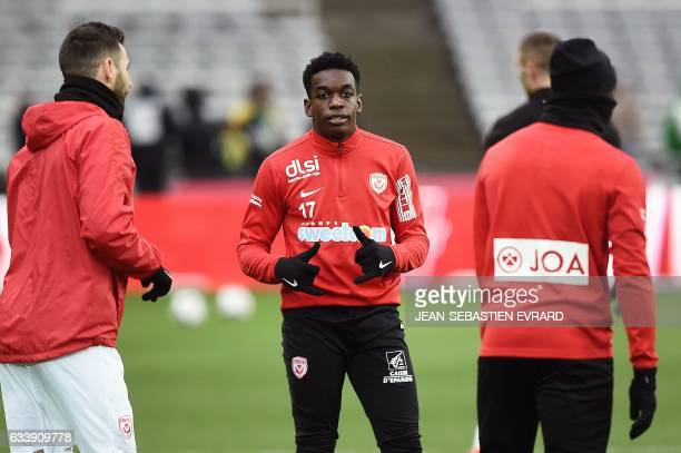 Nancy's French defender Faitout Maouassa thumbs up as he warms up during the French L1 football match between Nantes and Nancy on February 5 2017 at...