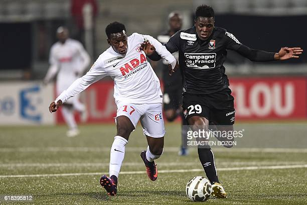 Nancy's French defender Faitout Maouassa vies for the ball against Caen's Haitian defender Romain Genevois during the French League Cup football...