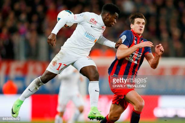 Nancy's French defender Faitout Maouassa vies for the ball with Caen's Croatian forward Ivan Santini during the French L1 football match between Caen...