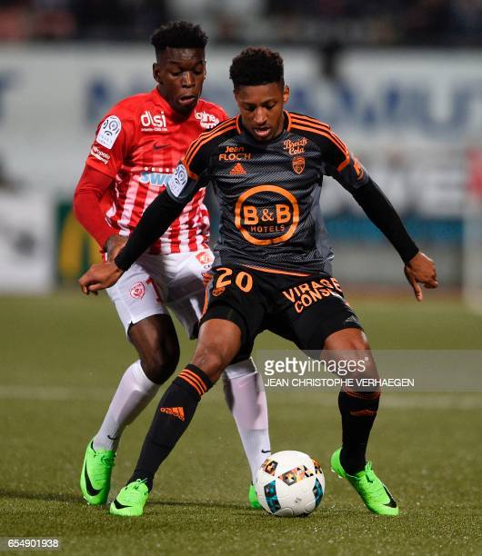Nancy's French defender Faitout Maouassa vies for the ball with Lorient's French defender Steven Moreira during the French L1 football match between...