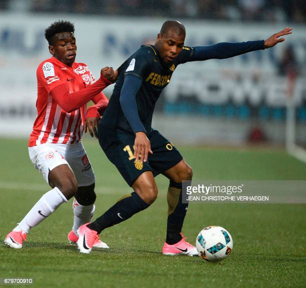 Nancy's French defender Faitout Maouassa vies for the ball with Monaco's French defender Djibril Sidibé during the French Ligue 1 football match...