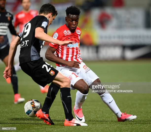 Nancy's French defender Faitout Maouassa vies for the ball with Rennes' French defender Romain Danze during the French L1 football match between...