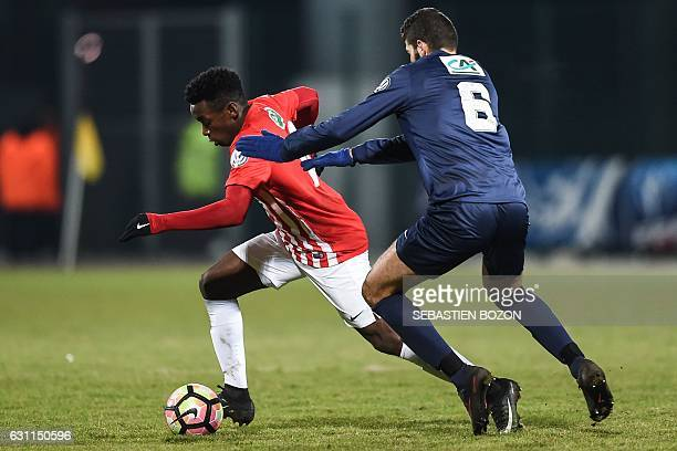 Nancy's French defender Faitout Maouassa vies with FC Besancon's French forward Elyes Hakkar during the French Cup football match between Besancon vs...