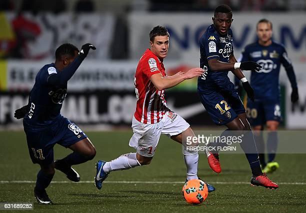 Nancy's French defender Joffrey Cuffaut fights for the ball with Bastia's French midfielder Lenny Nangis and Bastia's Malian midfielder Abdoulaye...