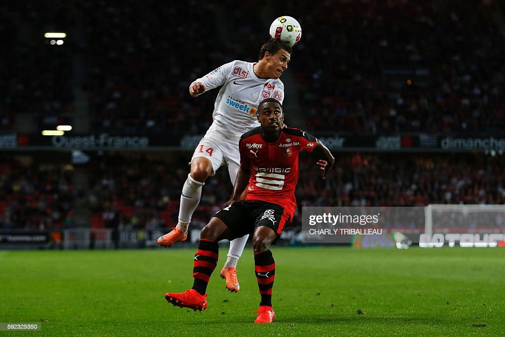 Nancy's French defender Joffrey Cuffaut vies for the ball with Rennes' French forward Wesley Said during the French L1 football match between Stade...