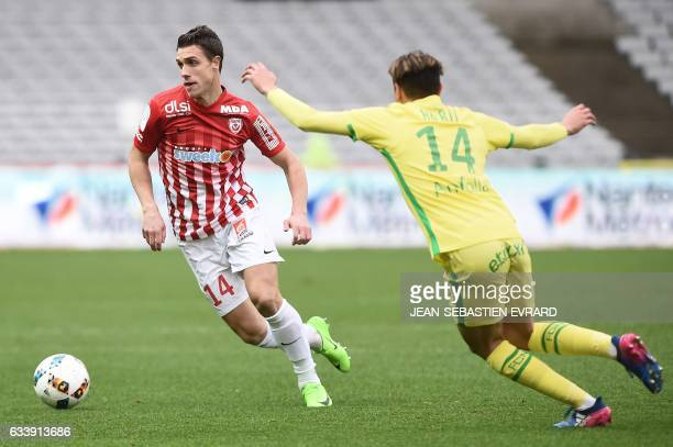 Nancy's French defender Joffrey Cuffaut vies with Nantes' French midfielder Amine Harit during the French L1 football match between Nantes and Nancy...