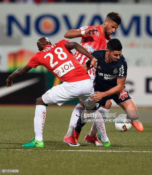 Nancy's French defender Julien Cetout and Nancy's French midfielder Youssef Ait Bennasser vie with Olympique de Marseille's French midfielder Morgan...