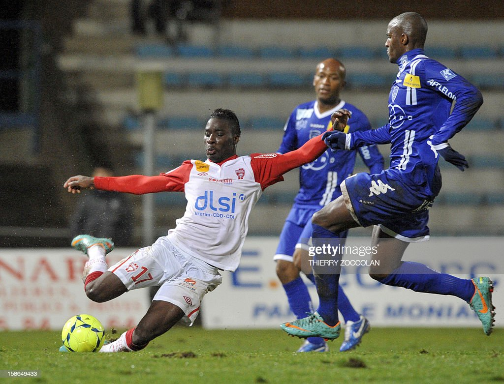 Nancy's French defender Massadio Haidara (L) vies for the ball with Bastia's French forward Anthony Modeste (R) during the French L1 football match Bastia vs Nancy, on December 22, 2012, at the Jean Laville stadium in Gueugnon.
