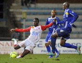Nancy's French defender Massadio Haidara vies for the ball with Bastia's French forward Anthony Modeste during the French L1 football match Bastia vs...