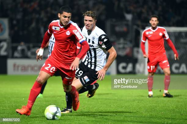 Nancy's French defender Michael Chretien outruns Angers' French forward Baptiste Guillaume during the French League Cup round of 16 football match...