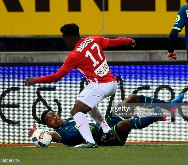 Nancy's French defender Nancy's French defender Faitout Maouassa vies with Lille's French defender Franck Beria during the French L1 football match...