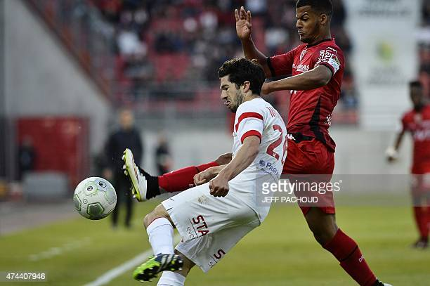 Nancy's French defender Vincent Muratori vies with Dijon's French forward Lois Diony during the French L2 football match Dijon vs Nancy on May 22 at...