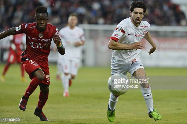 Nancy's French defender Vincent Muratori vies with Dijon's Ivorian defender Abdoulaye Bamba during the French L2 football match Dijon vs Nancy on May...