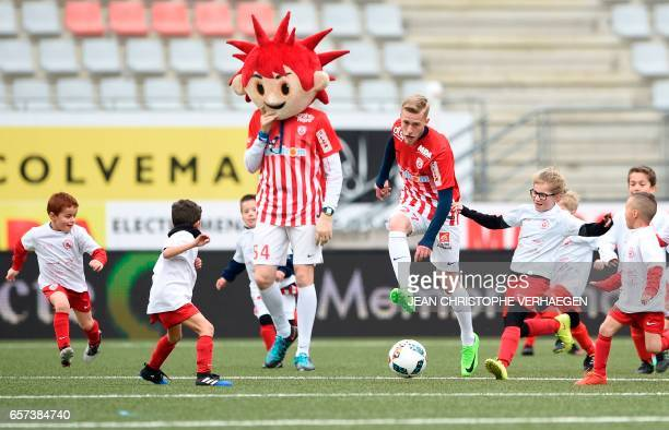 Nancy's French forward Alexis Busin plays football with 80 children during the curtain raiser of a 50hour match to mark the 50th anniversary of the...