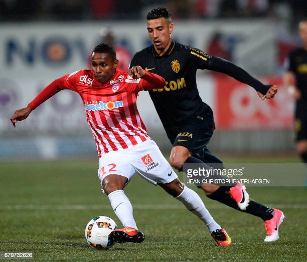 Nancy's French forward Christophe Mandanne vies for the ball with Monaco's Moroccan midfielder Nabil Dirar during the French Ligue 1 football match...